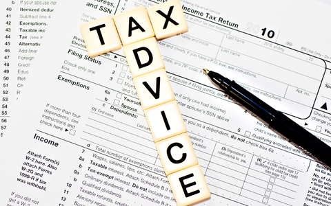 Tax Advice in tiles on top of tax document